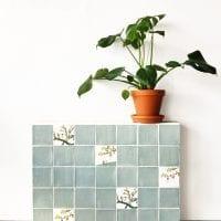 ocean green blanco tegels met plant